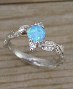 Nature inspired opal engagement ring with leaves
