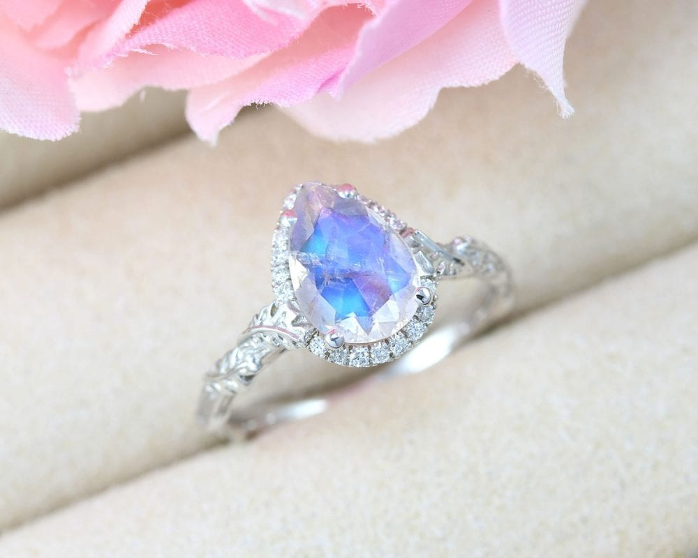pear moonstone engagement ring, nature inspired halo diamond ring