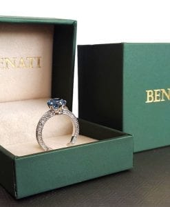 Engagement ring displayed in elegant green ring box for proposal