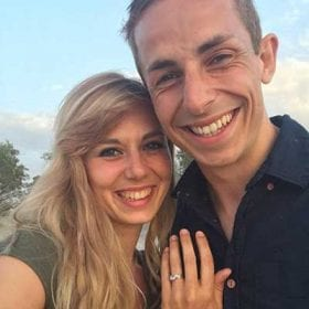 Happy women wearing engagement ring and man after proposal hugging happy benati clients